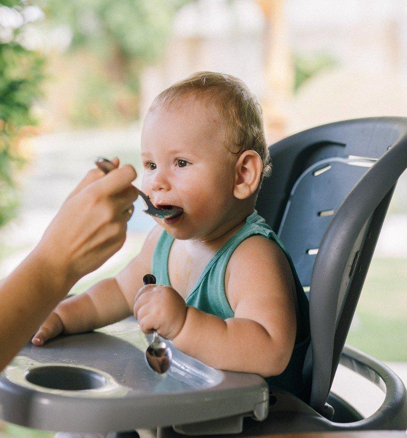 Infant boy eating